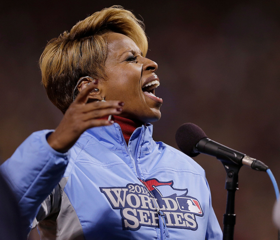 Description of . Mary J. Blige sings the national anthem before Game 1 of baseball's World Series between the Boston Red Sox and the St. Louis Cardinals Wednesday, Oct. 23, 2013, in Boston. (AP Photo/Charles Krupa)