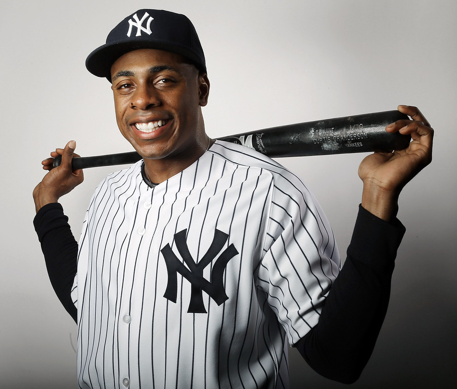 Description of . TAMPA, FL - FEBRUARY 20:  Curtis Granderson #14 of the New York Yankees poses for a portrait on February 20, 2013 at George Steinbrenner Stadium in Tampa, Florida.  (Photo by Elsa/Getty Images)