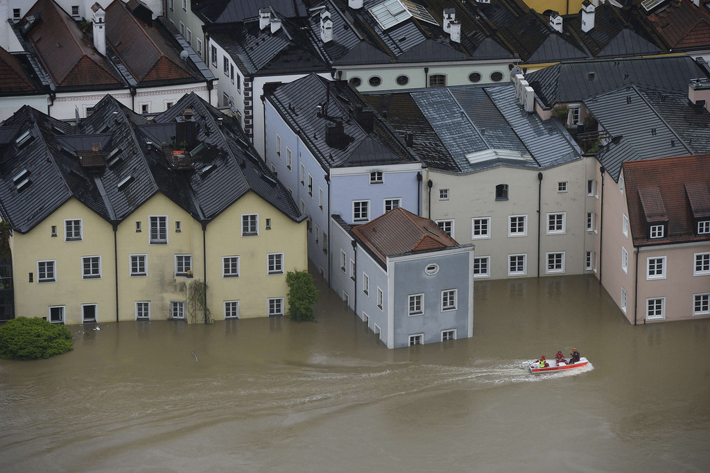 Description of . Rescue workers on a boat pass through the flooded old city of Passau, southern Germany, on June 3, 2013. Due to heavy and ongoing rainfalls, parts of the southern state of Bavaria were flooded.   CHRISTOF STACHE/AFP/Getty Images