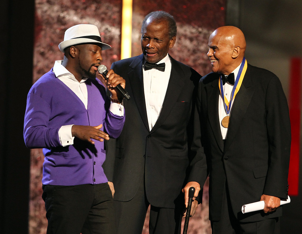 Description of . From left, Wyclef Jean and Sidney Poitier present the Spingarn award to Harry Belafonte at the 44th Annual NAACP Image Awards at the Shrine Auditorium in Los Angeles on Friday, Feb. 1, 2013. (Photo by Matt Sayles/Invision/AP)