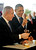 U.S. President Barack Obama, right, and Israeli Prime Minister Benjamin Netanyahu take a bite of matzah as they tour the Technology Expo in Jerusalem, Israel,Thursday, March 21, 2013. (AP Photo/Pablo Martinez Monsivais)