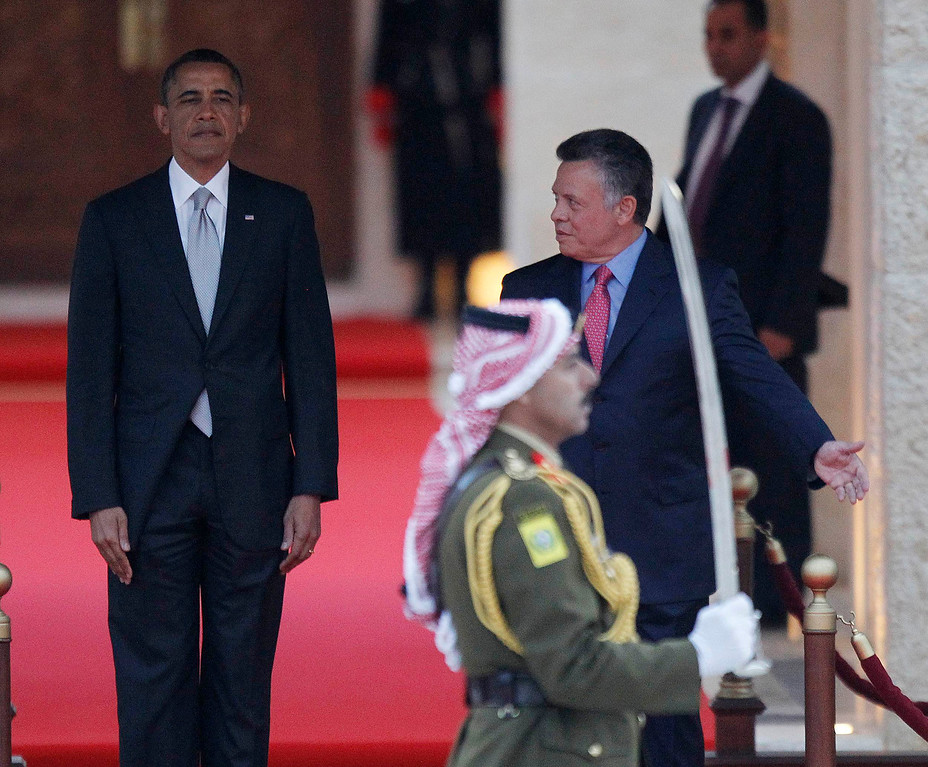 Description of . U.S. President Barack Obama participates in an official arrival ceremony with Jordan's King Abdullah II at Al-Hummar Palace, in Amman March 22, 2013. REUTERS/Jason Reed
