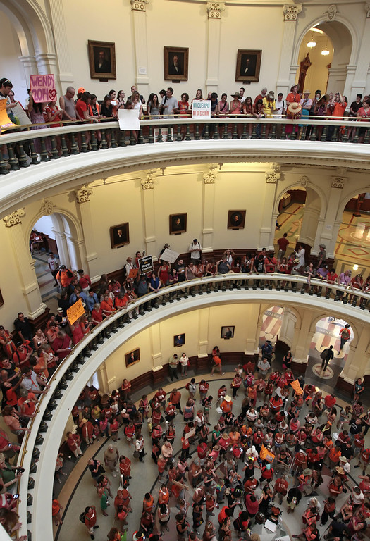 Description of . Pro-choice and pro-life supporters fill the Texas State capitol rotunda on July 1, 2013 in Austin, Texas. This is the first day of a second legislative special session called by Texas Gov. Rick Perry to pass a restrictive abortion law through the Texas legislature. The first attempt was defeated after opponents of the law were able to stall the vote until after first special session had ended.  (Photo by Erich Schlegel/Getty Images)