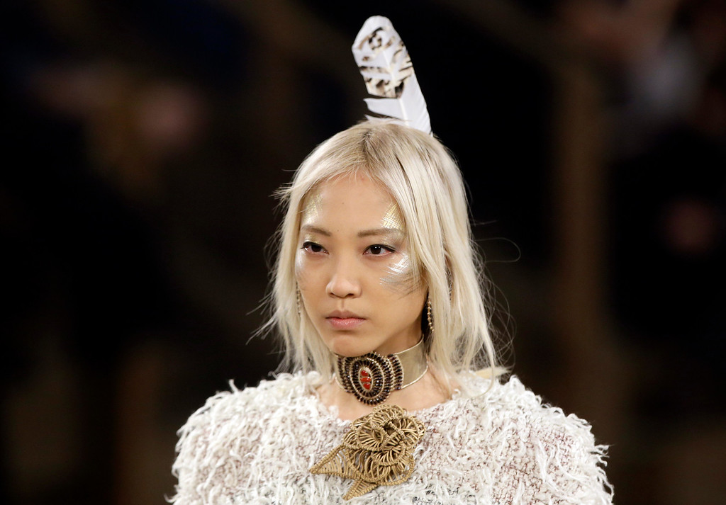 Description of . A model walks the runway at Chanel's Metiers d'Art fashion show, Tuesday, Dec. 10, 2013, in Dallas. (AP Photo/Tony Gutierrez)