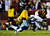 LANDOVER, MD - DECEMBER 30:  Madieu Williams #41 of the Washington Redskins tackles Dwayne Harris #17 of the Dallas Cowboys after a pass reception in the second quarter at FedExField on December 30, 2012 in Landover, Maryland.  (Photo by Patrick McDermott/Getty Images)