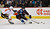DENVER, CO. - FEBRUARY 28: Gabriel Landeskog (92) of the Colorado Avalanche skates the puck in as he is shadowed by Jay Bouwmeester (4) of the Calgary Flames during the third period February 28, 2013 at Pepsi Center. The Colorado Avalanche defeated the Calgary Flames 5-4. (Photo By John Leyba/The Denver Post)