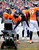 Denver Broncos strong safety Mike Adams (20) keeps warm in front of the heater during the third quarter.  The Denver Broncos vs Baltimore Ravens AFC Divisional playoff game at Sports Authority Field Saturday January 12, 2013. (Photo by Tim Rasmussen,/The Denver Post)