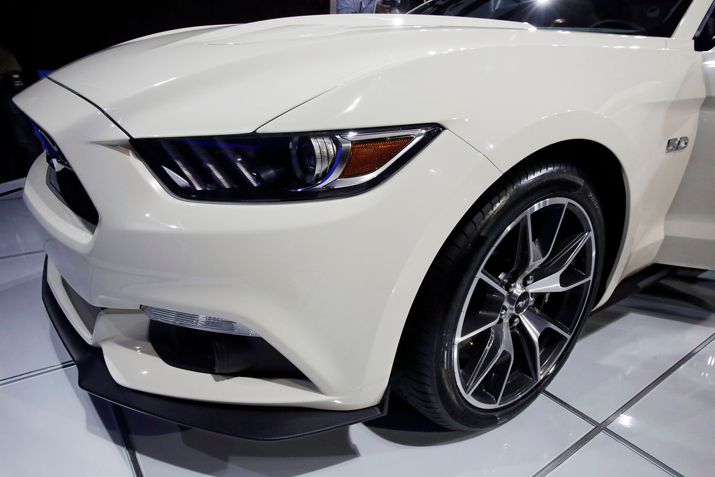 Description of . The 2015 Ford Mustang 50 Year Limited Edition is introduced at the 2014 New York International Auto Show at the Javits Convention Center, Wednesday, April 16, 2014, in New York. (AP Photo/Richard Drew)