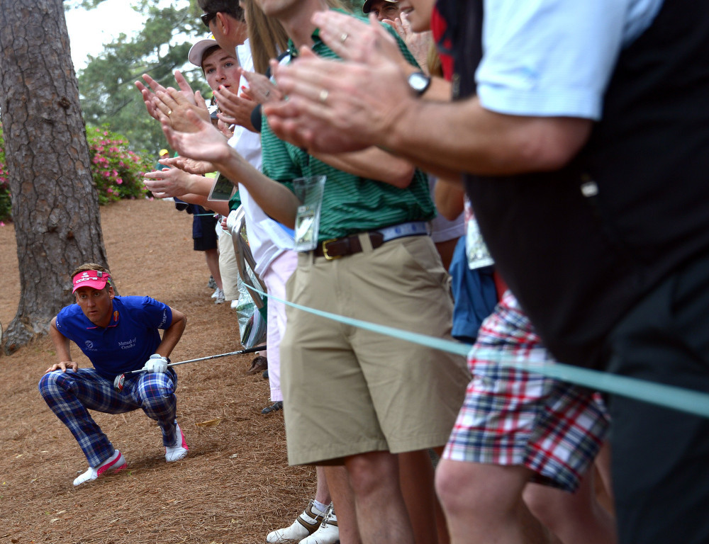 Description of . Ian Poulter of England plays during the first round of the 77th Masters golf tournament at Augusta National Golf Club on April 11, 2013 in Augusta, Georgia.   JIM WATSON/AFP/Getty Images