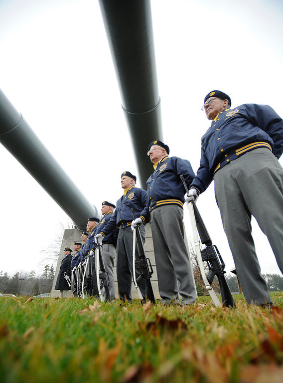 Description of . The State College American Legion Post 245 honor guard stands at attention during a Pearl Harbor Remembrance Day and ceremony at the Pennsylvania Military Museum, in Boalsburg, Pa., Friday, Dec. 7, 2012. (AP Photo/Centre Daily Times, Centre Daily Times, Nabil K. Mark)