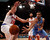 Denver Nuggets center JaVale McGee passes around New York Knicks forward Steve Novak in the first quarter of their NBA basketball game at Madison Square Garden in New York, December 9, 2012. REUTERS/Adam Hunger