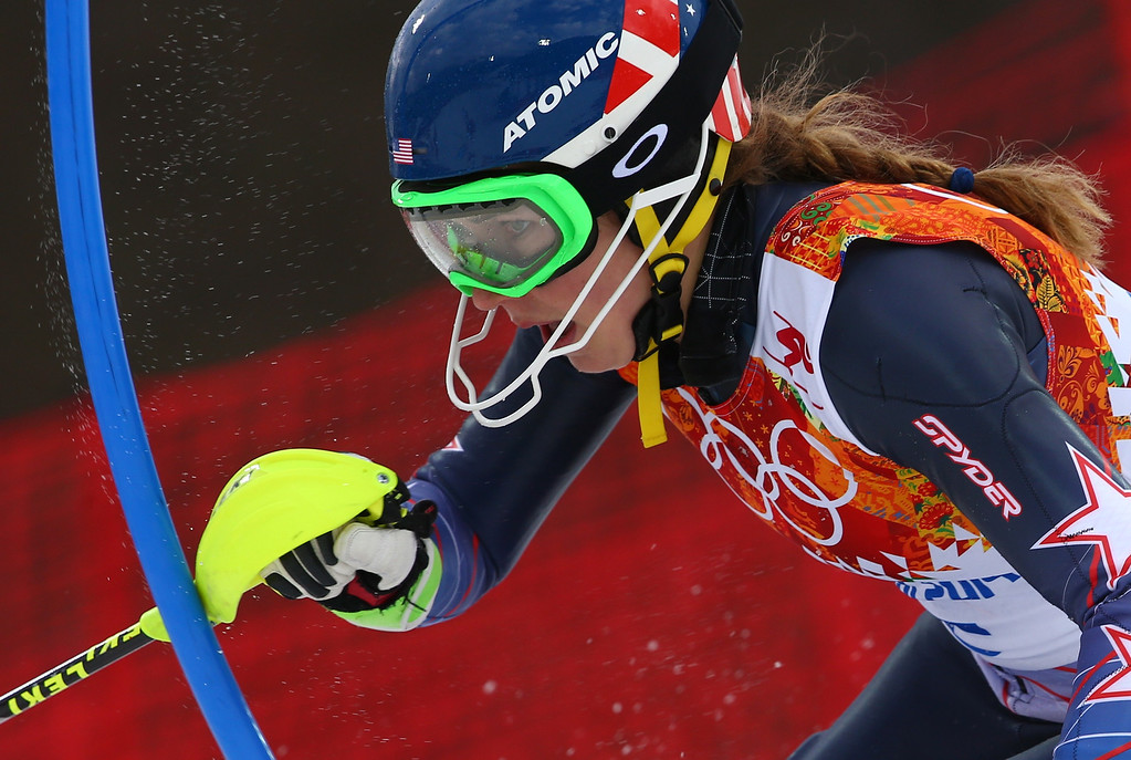 Description of . United States' Mikaela Shiffrin skis past a gate during the women's slalom at the Sochi 2014 Winter Olympics, Friday, Feb. 21, 2014, in Krasnaya Polyana, Russia. (AP Photo/Alessandro Trovati)
