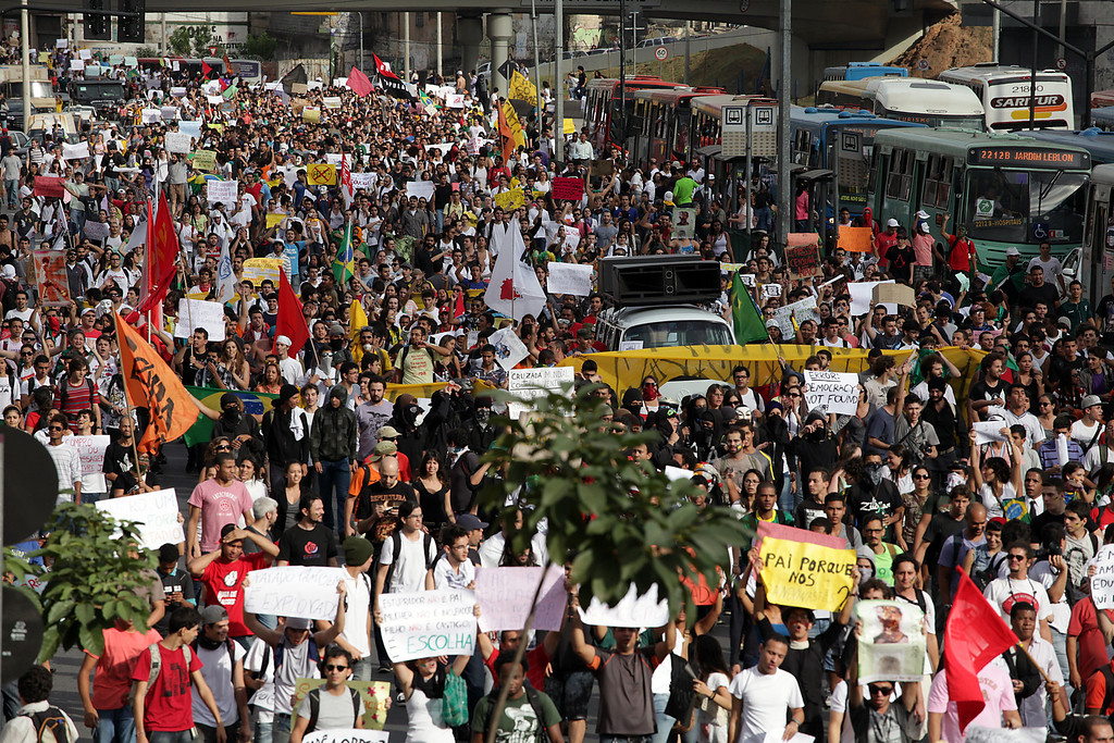 Description of . Hundreds of people march during a protest at the Antonio Carlos Avenue, next to Mineirao stadium which hosts the Confederations Cup, on June 17, 2013, in Belo Horizonte, state of Minas Gerais. Tens of thousands of people took to the streets of major Brazilian cities protesting the billions of dollars spent on the Confederations Cup --and preparations for the upcoming World Cup-- and against the hike in mass transit fares.   BERNARDO SALCE/AFP/Getty Images