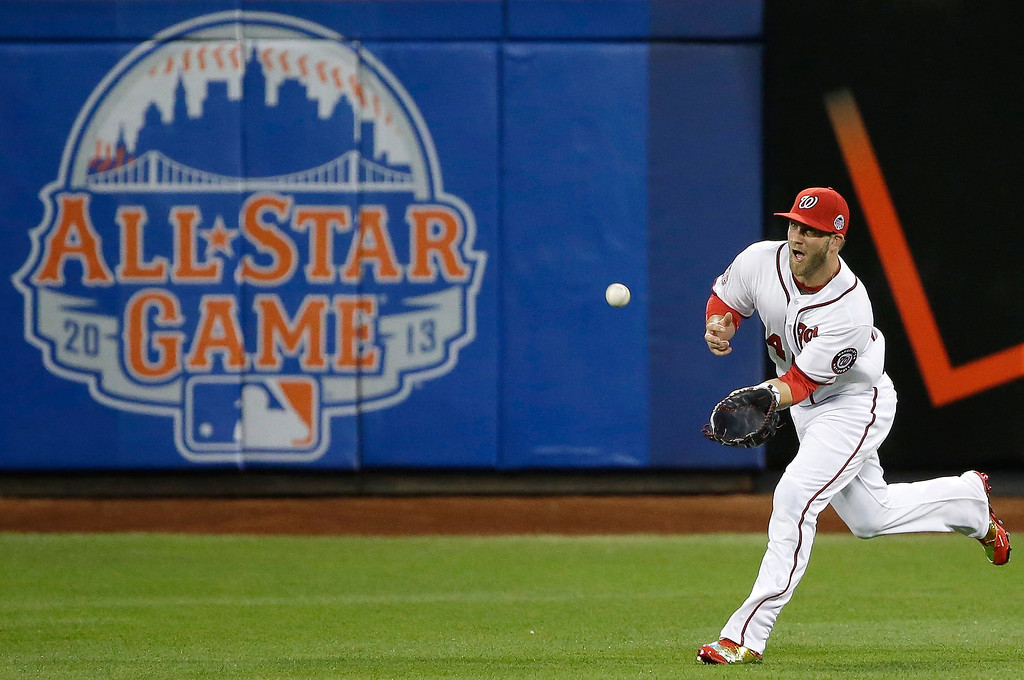 Description of . National Leagueís Bryce Harper, of the Washington Nationals, catches a fly ball to center field during the first inning of the MLB All-Star baseball game, on Tuesday, July 16, 2013, in New York. (AP Photo/Matt Slocum)