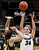 Colorado's Jen Reese (34) shoots over Wyoming's Ashley Sickles during their NCAA college basketball game, Wednesday, Nov. 28, 2012, in Boulder, Colo. (AP Photo/The Daily Camera, Jeremy Papasso)