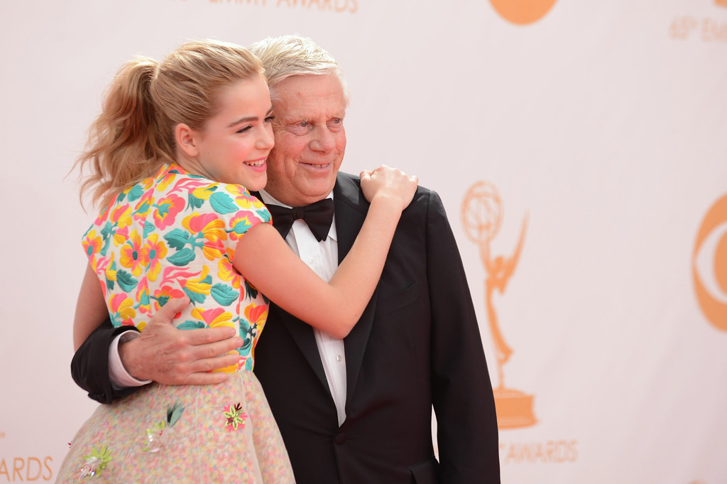 Description of . Kiernan Shipka and Robert Morse arrive at the 65th Primetime Emmy Awards at Nokia Theatre on Sunday, Sept. 22, 2013, in Los Angeles.  (Photo by Jordan Strauss/Invision/AP)