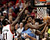 Denver Nuggets small forward Kenneth Faried (35) shoots as Portland Trail Blazers center J.J. Hickson (21) defends during first quarter of their NBA basketball game in Portland, Oregon, December 20, 2012.  REUTERS/Steve Dipaola
