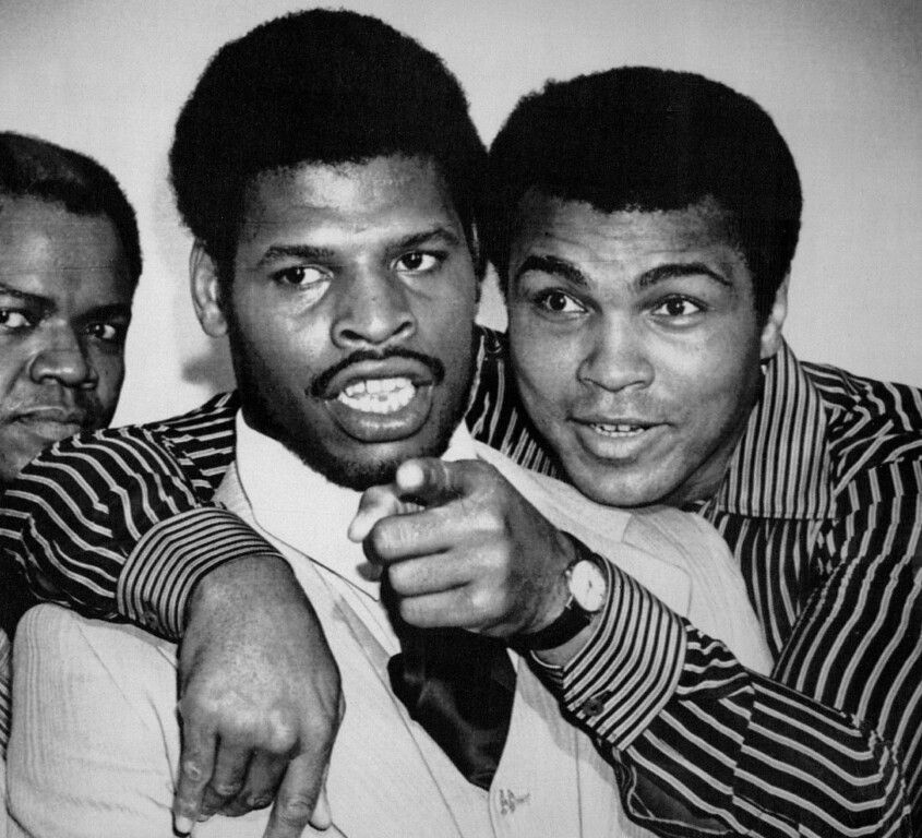 Description of . Embracing The Champ -- Muhammad Ali embraces heavyweight champion Leon Spinks during a news conference in New Orleans where they signed to fight Sept. 15, in the Superdome. Ali was giving the champion a few pointers on dealing with the press. 1978. Credit: AP Laserphoto
