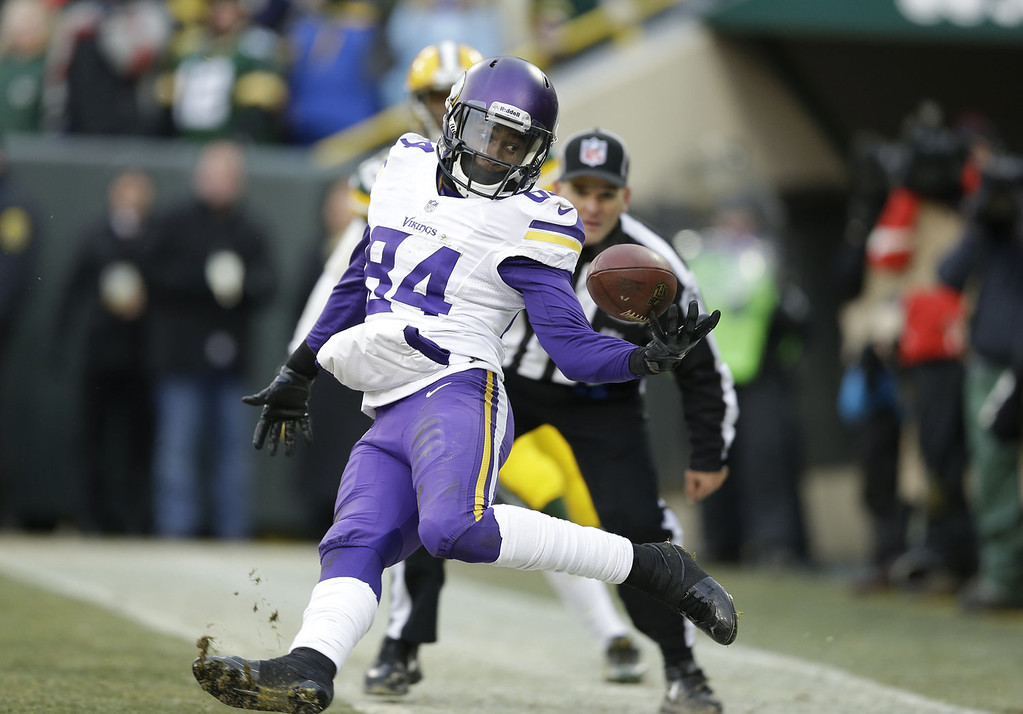 Description of . Cordarrelle Patterson #84 of the Minnesota Vikings cannot hold onto the ball in the back of the end zone against the Green Bay Packers that would have won the game at Lambeau Field on November 24, 2013 in Green Bay, Wisconsin.  (Photo Tom Lynn /Getty Images)