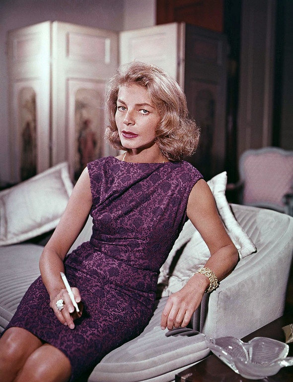 . FILE - This 1965 file photo shows actress Lauren Bacall at her home in New York. Bacall, the sultry-voiced actress and Humphrey Bogart�s partner off and on the screen, died Tuesday, Aug. 12, 2014 in New York. She was 89. (AP Photo, File)