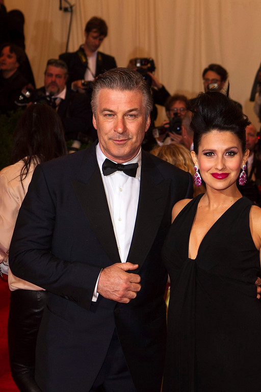 Description of . Actor Alec Baldwin arrives with wife Hilaria Thomas at the Metropolitan Museum of Art Costume Institute Benefit celebrating the opening of