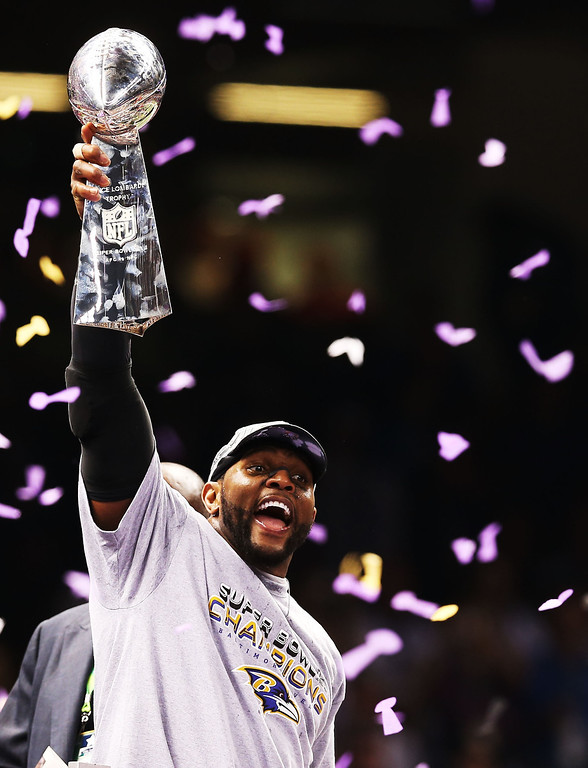 Description of . Ray Lewis #52 of the Baltimore Ravens celebrates with the Vince Lombardi trophy after the Ravens won 34-31 against the San Francisco 49ers during Super Bowl XLVII at the Mercedes-Benz Superdome on February 3, 2013 in New Orleans, Louisiana.  (Photo by Christian Petersen/Getty Images)