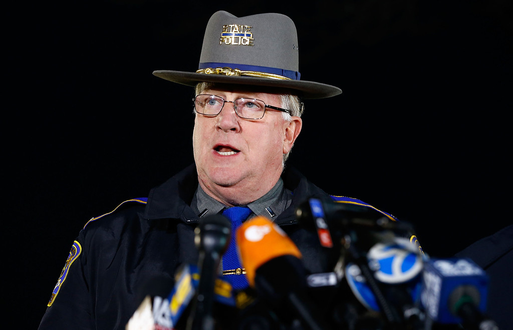 Description of . State Police spokesman Lt. J. Paul Vance briefs the media about the elementary school shooting during a press conference at Treadwell Memorial Park on December 14, 2012 in Newtown, Connecticut. According to reports, there are 27 dead, including 20 children, after a gunman identified as Adam Lanza, opened fire in at the Sandy Hook Elementary School in Newtown, Connecticut. The shooter, identified as Adam Lanza was also found dead at the scene. (Photo by Jared Wickerham/Getty Images)