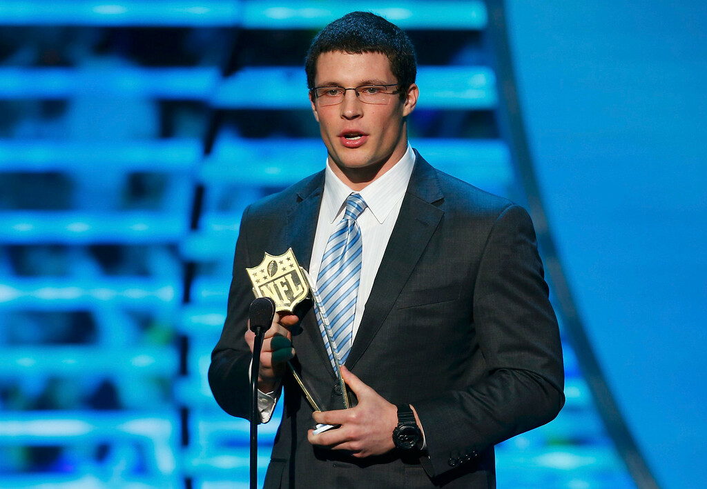 Description of . Carolina Panthers linebacker Luke Kuechly accepts the award for NFL Defensive Rookie of the Year during the NFL Honors award show in New Orleans, Louisiana February 2, 2013.  REUTERS/Jeff Haynes