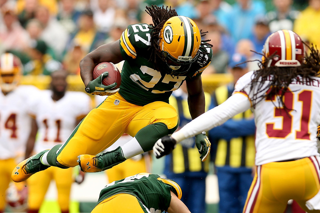 Description of . Eddie Lacy #27 of the Green Bay Packers carries the ball against the the Washington Redskins at Lambeau Field on September 15, 2013 in Green Bay, Wisconsin.  (Photo by Matthew Stockman/Getty Images)