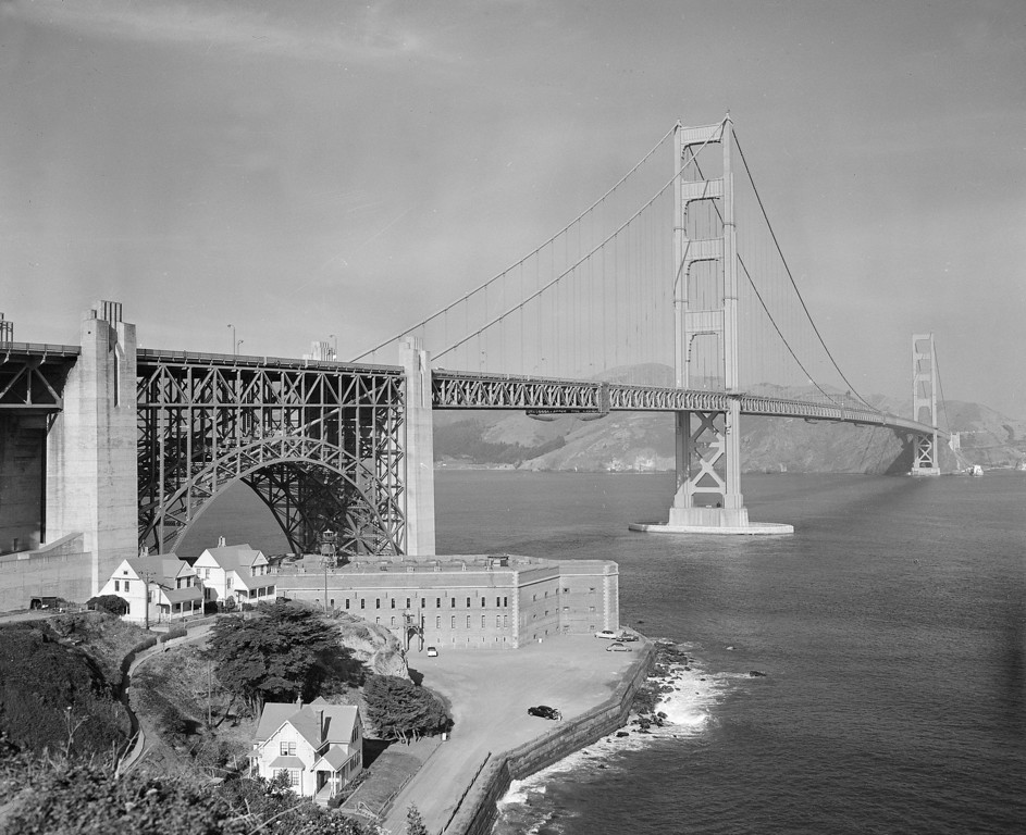 Description of . The Golden Gate Bridge, with Fort Point at bottom left, is seen Dec. 15, 1958.  (AP Photo/Ernest K. Bennett)