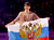 First place finishers Tatiana Volosozhar (L) and Maxim Trankov of Russia pose with their country's flag during the presentation ceremony following the free skating programs at the ISU World Figure Skating Championships in London, March 15, 2013.   REUTERS/Mark Blinch