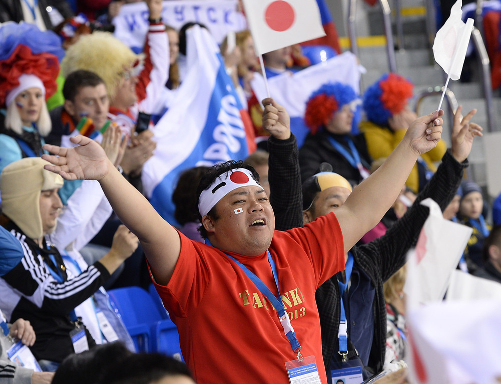Description of . A Japanese supporters cheers on his team during the Women\'s Ice Hockey Group B match Russia vs Japan at the Shayba Arena during the Sochi Winter Olympics on February 11, 2014.  JONATHAN NACKSTRAND/AFP/Getty Images