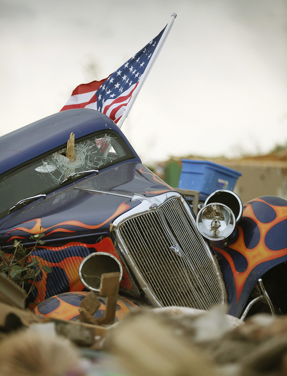 Description of . A 1934 Ford rests at homesite of Dan Wassum, who was killed when a tornado destroyed his home April 29, 2014 in Vilonia, Arkansas. Deadly tornadoes ripped through the region April 27, leaving more than a dozen dead.  (Photo by Mark Wilson/Getty Images)
