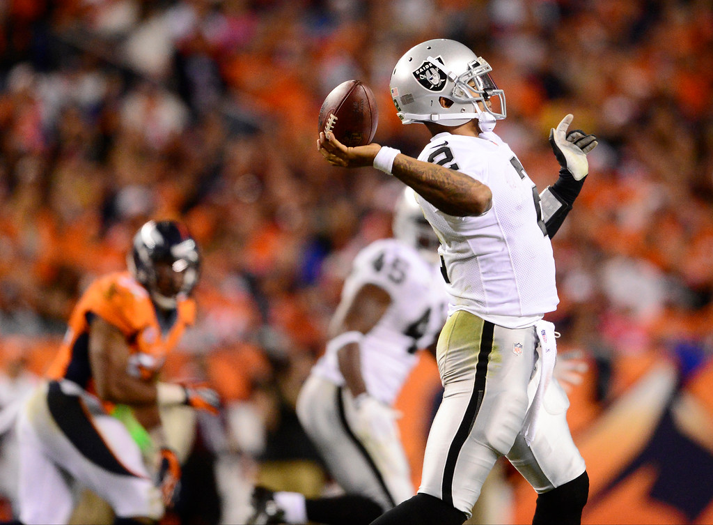 Description of . Oakland Raiders quarterback Terrelle Pryor (2) makes a throw in the third quarter. The Denver Broncos took on the Oakland Raiders at Sports Authority Field at Mile High in Denver on September 23, 2013. (Photo by AAron Ontiveroz/The Denver Post)