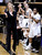 Colorado head coach Linda Lappe cheers after a score against Wyoming during their NCAA college basketball game, Wednesday, Nov. 28, 2012, in Boulder, Colo. (AP Photo/The Daily Camera, Jeremy Papasso)