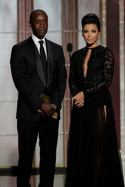 Description of . Presenters Don Cheadle (L) and Eva Longoria on stage at the 70th annual Golden Globe Awards in Beverly Hills, California January 13, 2013, in this picture provided by NBC. REUTERS/Paul Drinkwater/NBC/Handout