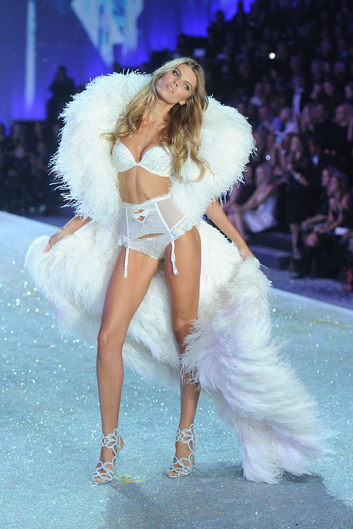 Description of . Model Maryna Linchuk walks the runway at the 2013 Victoria's Secret Fashion Show at Lexington Avenue Armory on November 13, 2013 in New York City.  (Photo by Jamie McCarthy/Getty Images)
