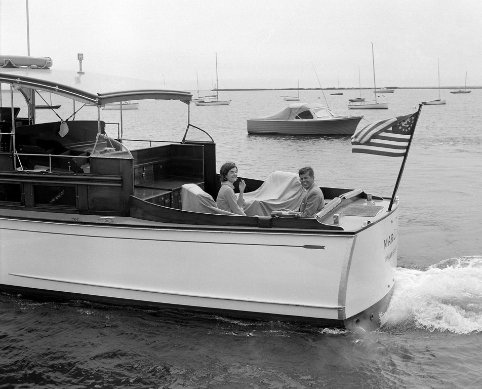 Description of . Sen. Kennedy and wife Jacqueline cruise aboard the  Marlin for a sail around Nantucket Sound on July 19, 1960.  The Kennedys were on vacation in Hyannisport.  Harvey Georges, Associated Press file