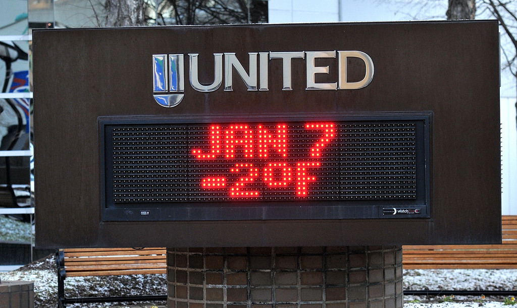 . At 8:30 a.m. the temperature outside the United Bank building is minus two degrees in  Charleston, W. Va., Tuesday Jan. 7, 2014.s  Brutal, record-breaking cold descended on the East and South, sending the mercury plummeting Tuesday .  (AP Photo/The Daily Mail, Craig Cunningham )