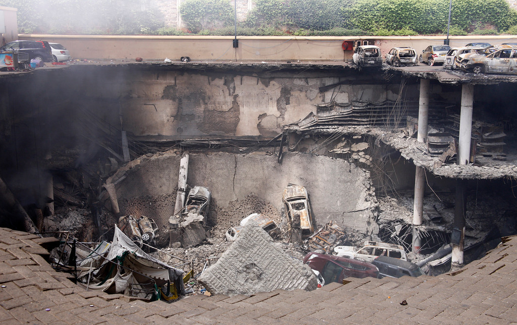 Description of . This photo released by the Kenya Presidency shows the collapsed upper car park of the Westgate Mall in Nairobi, Kenya Thursday, Sept. 26, 2013.  (AP Photo/Kenya Presidency)