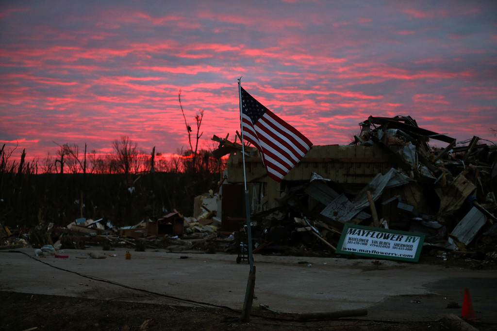 Description of . The sun rises behind a business that was destroyed by a tornado last Sunday, on April 30, 2014 in Mayflower, Arkansas. Late last Sunday afternoon, a number of deadly tornadoes ripped through the region leaving more than a dozen dead.  (Photo by Mark Wilson/Getty Images)