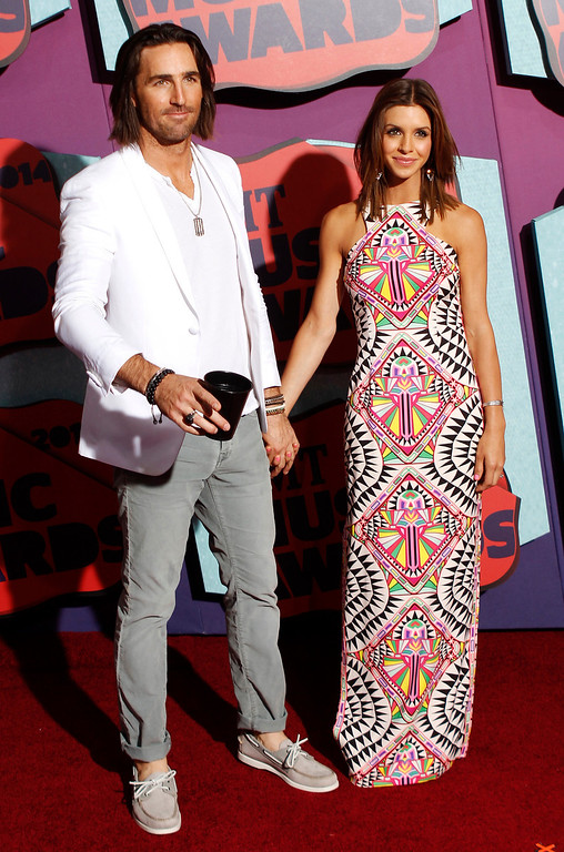 Description of . Jake Owen, left, and Lacey Buchanan Owen arrive at the CMT Music Awards at Bridgestone Arena on Wednesday, June 4, 2014, in Nashville, Tenn. (Photo by Wade Payne/Invision/AP)
