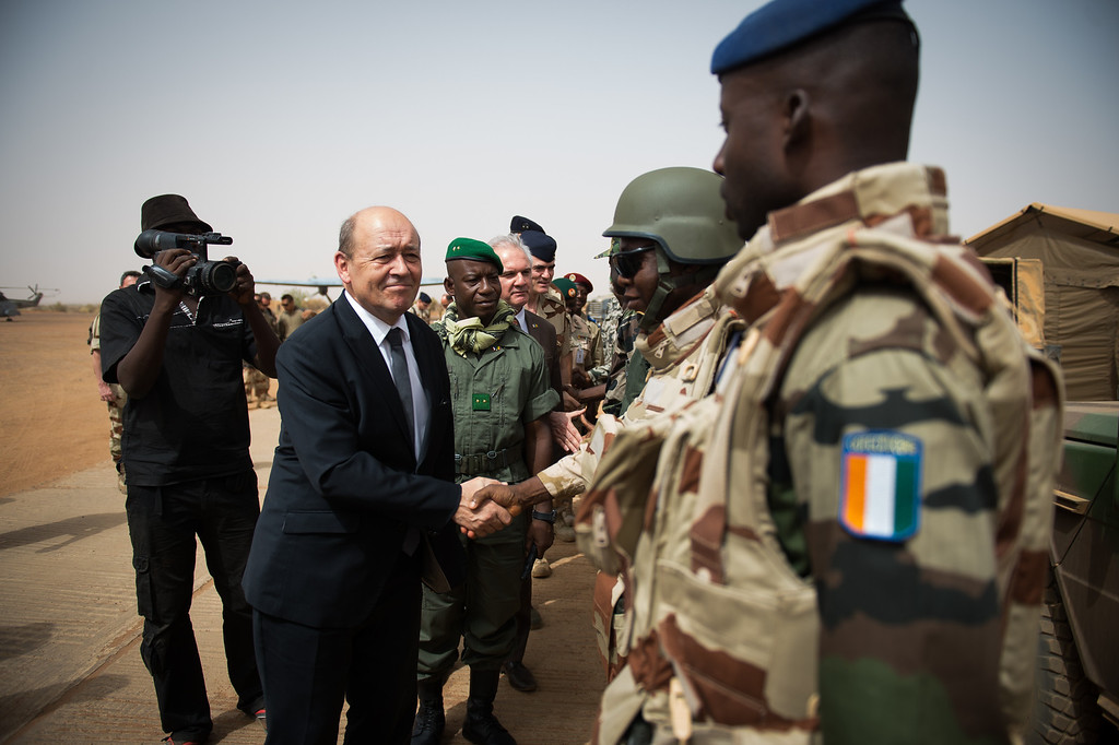 Description of . French Defence Minister Jean-Yves Le Drian shakes hands with African soldiers of Serval Operation, on April 26, 2013 in French Army base of Gao. MARTIN BUREAU/AFP/Getty Images