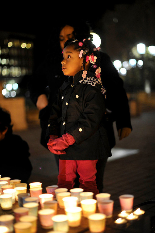 Description of . Aminah Crawford, 4, joins in a vigil commemorating victims of a Connecticut elementary school shooting in Oakland, California, December 14, 2012. Twenty schoolchildren were slaughtered by a heavily armed gunman who opened fire at a suburban elementary school in Connecticut on Friday, ultimately killing at least 27 people including himself in the one of the worst mass shootings in U.S. history. The 20-year-old gunman, identified by law enforcement sources as Adam Lanza, fired what witnesses described as dozens of shots at Sandy Hook Elementary School in Newtown, Connecticut, which serves children from ages 5 to 10.  REUTERS/Noah Berger