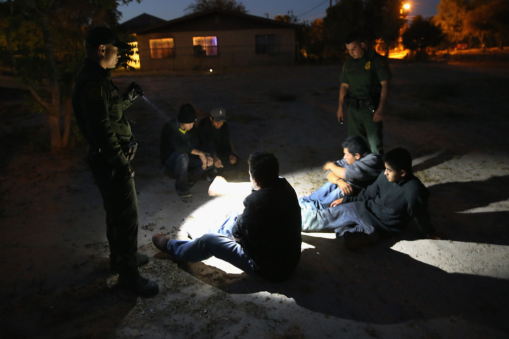 Description of . MISSION, TX - APRIL 11: U.S. Border Patrol agents detain undocumented immigrants who had crossed from Mexico into the United States on April 11, 2013 in Mission, Texas. In the last month the Border Patrol\'s Rio Grande Valley sector has seen a spike in the number of immigrants crossing the river from Mexico into Texas. With more apprehensions, they have struggled to deal with overcrowding while undocumented immigrants are processed for deportation. According to the Border Patrol, undocumented immigrant crossings have increased more than 50 percent in Texas\' Rio Grande Valley sector in the last year. Border Patrol agents say they have also seen an additional surge in immigrant traffic since immigration reform negotiations began this year in Washington D.C. Proposed refoms could provide a path to citizenship for many of the estimated 11 million undocumented workers living in the United States.  (Photo by John Moore/Getty Images)