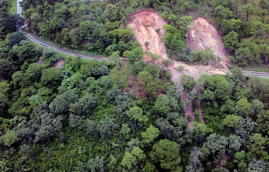 Description of . This handout photo taken and released on September 18, 2013 by Mexico's Interior Ministry press office shows an aerial view of landslides along the highway going to Acapulco, in the Mexican state of Guerrero, as heavy rains hit the country.  AFP PHOTO/ Interior MINISTRY -/AFP/Getty Images
