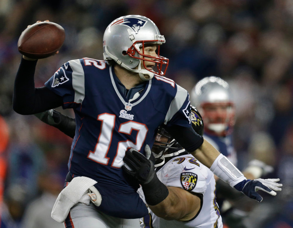 Description of . New England Patriots quarterback Tom Brady is pressured by Baltimore Ravens defensive end Haloti Ngata (92) during the first half of the NFL football AFC Championship football game in Foxborough, Mass., Sunday, Jan. 20, 2013. (AP Photo/Steven Senne)