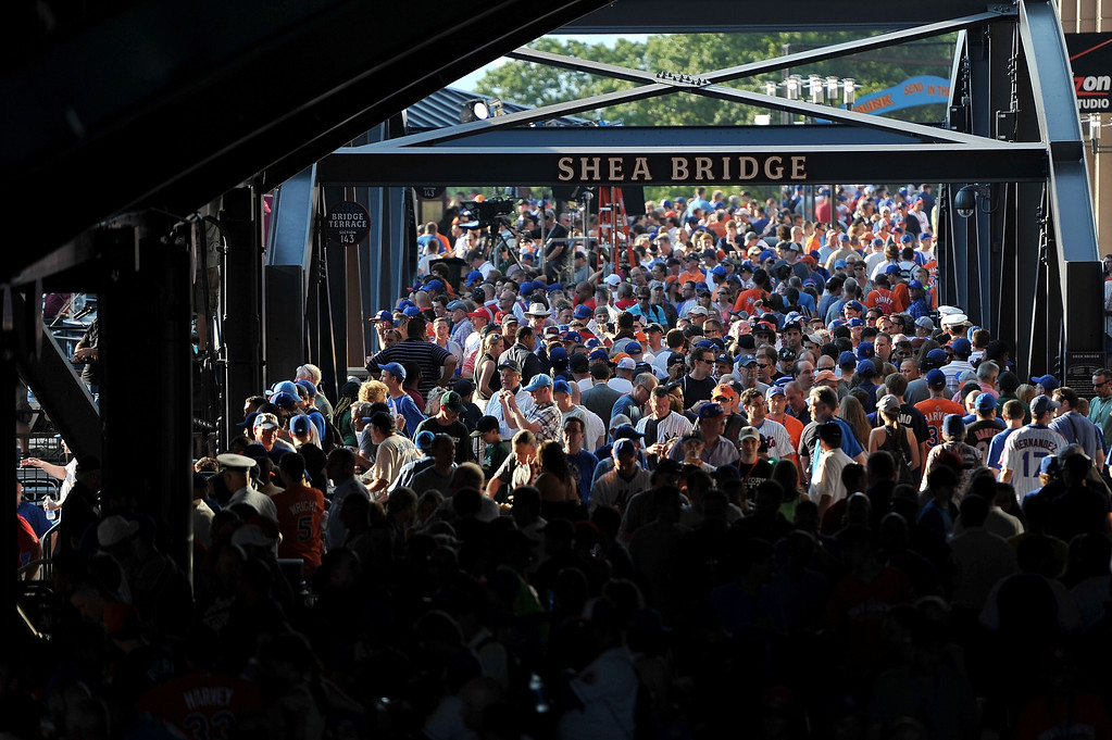 Description of . Fans walk across Shea Bridge prior to the 84th MLB All-Star Game on July 16, 2013 at Citi Field in the Flushing neighborhood of the Queens borough of New York City.  (Photo by Drew Hallowell/Getty Images)