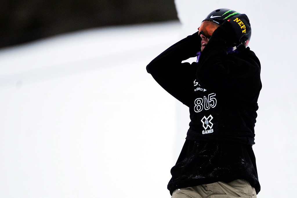Description of . ASPEN, CO. - JANUARY 24: Sage Kotsenburg reacts to falling during the men's Snowboard Slopestyle elimination. Men's Snowboard Slopestyle elimination X Games Aspen Buttermilk Mountain Aspen January 24, 2013. (Photo By AAron Ontiveroz / The Denver Post)
