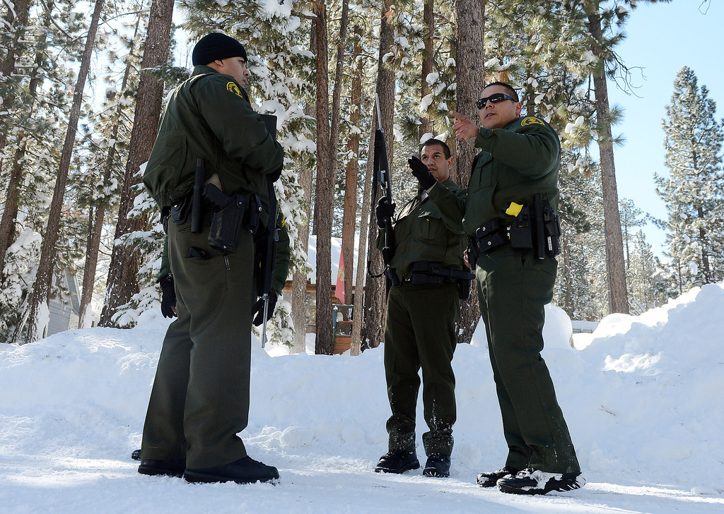 Description of . (Will Lester/Staff Photographer)  San Bernardino County Sheriff deputies continue to search door-to-door along Willow Avenue in Big Bear for ex-LAPD fugitive Christopher Jordan Dorner Saturday February 9, 2013. Search conditions improved Saturday as skies cleared in the area after a heavy winter storm dropped over a foot of snow in the mountain community Friday.